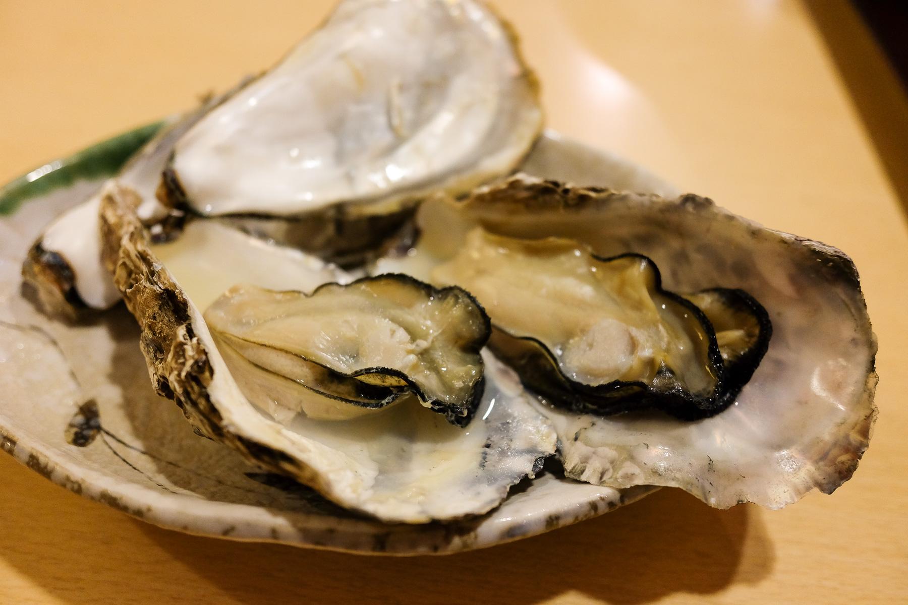 In Sake gedämpfte Austern.
